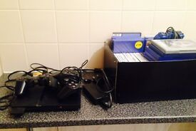 SLIMLINE PLAYSTATION 2 WITH OVER 30 GAMES AND WIRELESS CONTROLLER