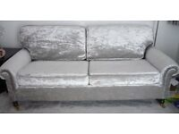 MATCHING PAIR OF SILVER CRUSHED VELVET 3-SEATER SOFAS WITH MAHOGANY TURNED LEGS AND BRASS CASTORS