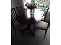 Dark Wood Extending dining table and 4 chairs