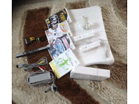 REDUCED PRICE wii , wii board , two controllers and four games