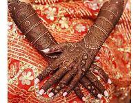 Mehendi art on hands and feet