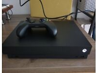 Xbox One X 1 TB Console 10 games and 2 controllers