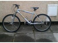 18 Speed Track men's adult, front suspension bicycle.