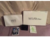 Boxed black Nintendo Wii 2 controls & boxed black Wii fit board & games, charging station