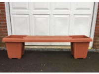garden bench with 2 planters either end