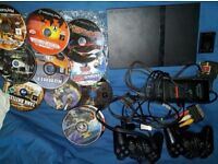 ps2 slim with 25 games pad and memory card