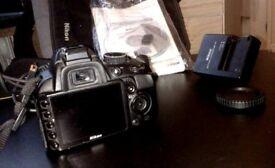 Nikon D3100 + VR 18-55mm