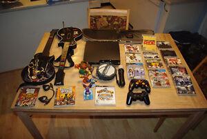 PS3 avec plusieurs accessoires et jeux