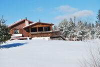 BEAUTIFUL LOG HOME IN A VERY QUIET LOCATION