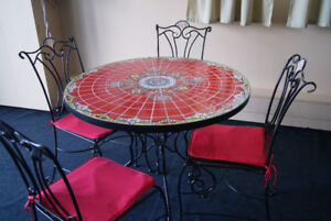 wrought iron ceramic top table and chairs
