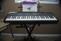 Keyboard/piano, with stand and learning books - moving sale