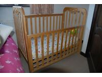 Baby cot with mattress and drop side