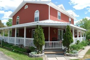 House for sale with acreage and two rental units!