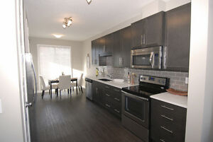 BRAND NEW: Bright, airy condo for sale w garage