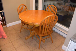 Solid wood kitchen table and 3 matching chairs