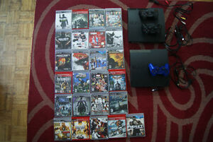 Two PS3 three controllers and 25 games West Island Greater Montréal image 1