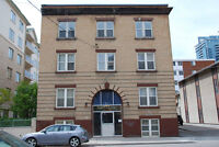 Bachelor and 1 bedroom units in character downtown building