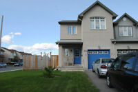 Spacious 4+1 Bedroom townhouse corner unit on a large fenced lot