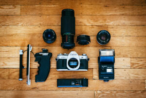 Cannon AE-1 Film Camera/Lenses (28mm.50mm.70-300mm) and extras!