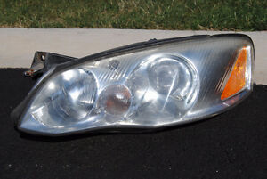 DRIVERS Side 2002 Mazda Millenia Headlight