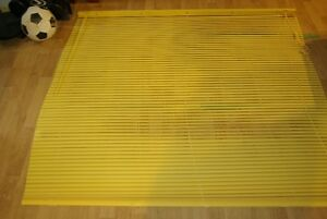 Yellow/Butter colored horizontal blinds