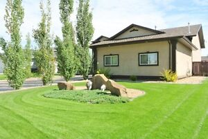 ACREAGE LIKE LIVING IN TOWN! $20,000 PRICE REDUCTION! 2 GARAGES