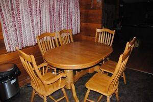 oak dining table with eight matching chairs
