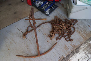 Antique boat ANCHOR on a long chain