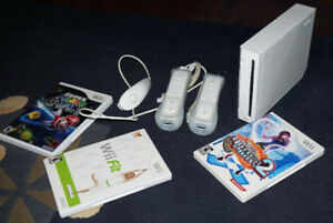 Wii console with controller, nunchuk and games