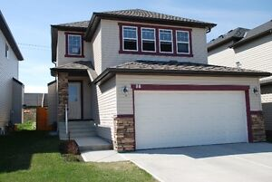 Beautiful 2 bedroom with attached garage in Okotoks!