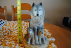wolf and cubs statue