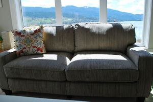 TWO COMPLETELY BRAND NEW, BEAUTIFUL TAUPE SOFAS FOR SALE