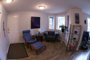 Fully upgraded Canmore condo - low condo dues, private yard