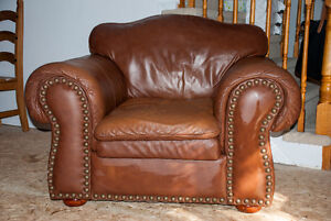 LARGE BROWN LEATHER CHAIR WITH METAL STUDS
