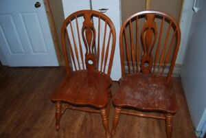 Kitchen Solid wood table with three chairs for sale.