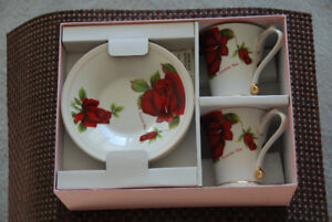 2 Tea sets, each with two cups and saucers.