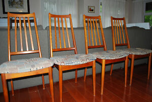 Set of 4 solid Teak chairs, look new