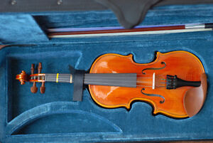 1/8 hand made solid wood violin.