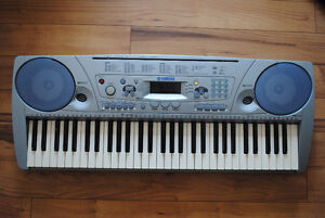 Yamaha PSR-273 Electronic Portable Keyboard with stand