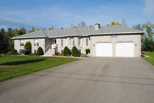 CUSTOM-BUILT RANCH BUNGALOW LOCATED JUST EAST OF BROCKVILLE