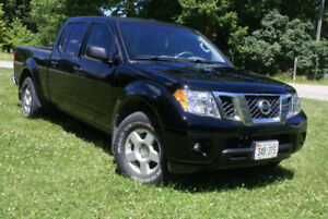 2015 Nissan Frontier sv 4x4  (save on gas)