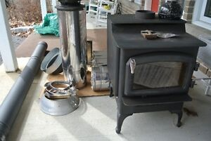 Regency steptop wood stove and Selkirk chimney.