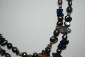 Stunning hand made black pearl and lapis neclace