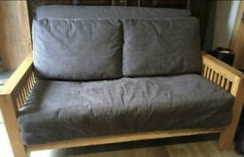 Two seater solid oak futon sofa by Futon Company showroom condition