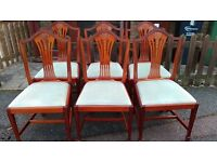 6 dining chairs, Yew wood, carved back,clean cushion, very good condition, stable