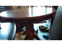 Round dining table,solid oak,non-extendable,carved,105 cm,adjust screw,no chair