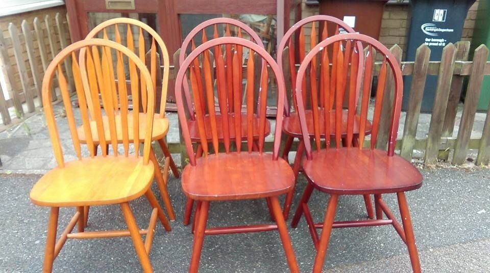 6 dining chairs,solid teak,Windsor style,1 chair a little wobbly but other 5 chairs are very stable