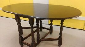 Oval dining table,solid oak,8 carved gate legs,150cm,wear & scratches,no chair