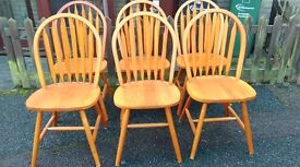 6 dining chairs,solid teak,Windsor style,a little wear but good condition,no table
