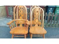 4 dining chairs,solid oak,carved high back,good physical condition,no table